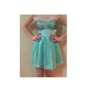 Teal dancing dress.